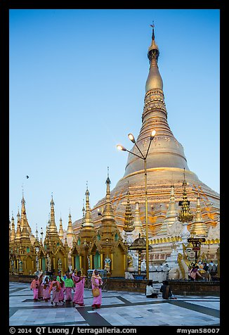 Nuns walking at the base of main chedi, Shwedagon Pagoda. Yangon, Myanmar (color)