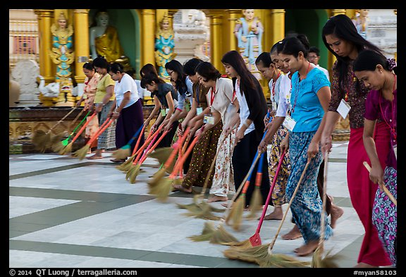 Women lining up to sweep the platform, Shwedagon Pagoda. Yangon, Myanmar (color)