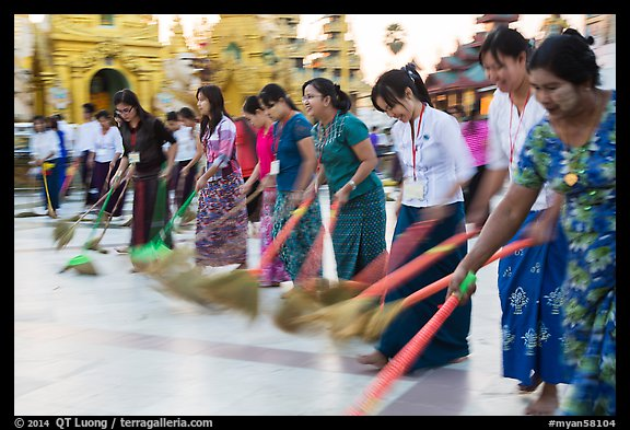 Row of women sweeping, Shwedagon Pagoda. Yangon, Myanmar (color)