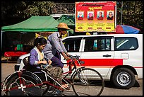 Trishaw, taxi, and billboard promoting monks. Yangon, Myanmar ( color)