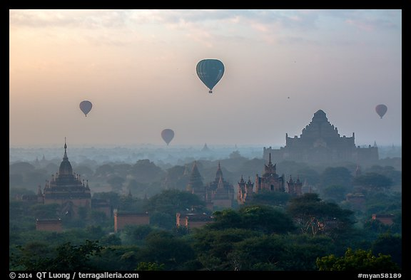 Aerial view of ancient temples and hot air ballons at sunrise. Bagan, Myanmar (color)