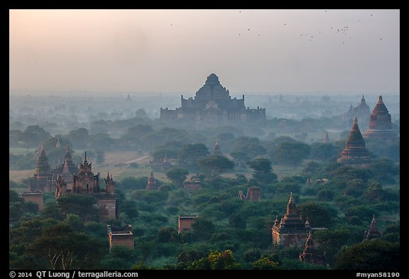 Aerial view of ancient temples in sunrise mist. Bagan, Myanmar (color)