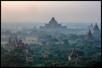 Aerial view of ancient temples in sunrise mist. Bagan, Myanmar ( color)