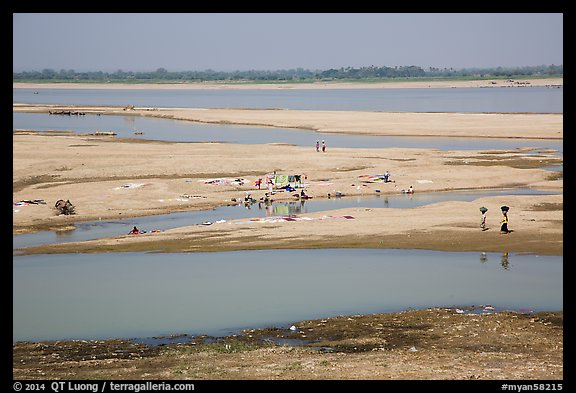 Sandy banks of Ayeyarwaddy River with villagers washing clothes. Bagan, Myanmar (color)