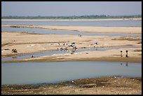 Sandy banks of Ayeyarwaddy River with villagers washing clothes. Bagan, Myanmar ( color)