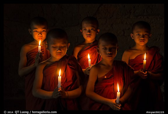 Young buddhist novices holding candles. Bagan, Myanmar (color)