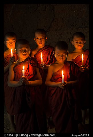 Group of buddhist novices holding candles. Bagan, Myanmar (color)