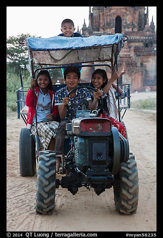 Children driving tractor, Minnanthu village. Bagan, Myanmar (color)