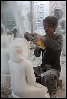 Man carving marble buddha statue with grinder. Mandalay, Myanmar ( color)