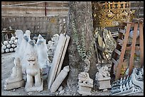 Assortment of sculptures, Marble street. Mandalay, Myanmar ( color)