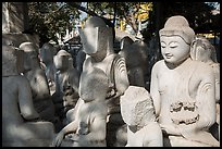 Buddha statues in various stages of completion on Marble street. Mandalay, Myanmar ( color)