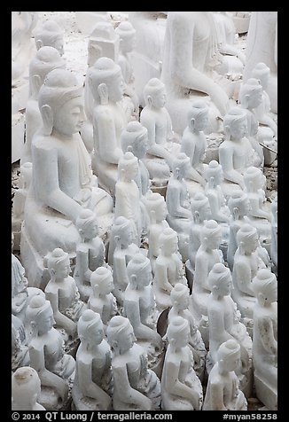 Unfinished white marble buddha statues of various sizes. Mandalay, Myanmar (color)