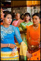 Women wearing their best dress for Shinbyu ceremony, Mahamuni Pagoda. Mandalay, Myanmar ( color)