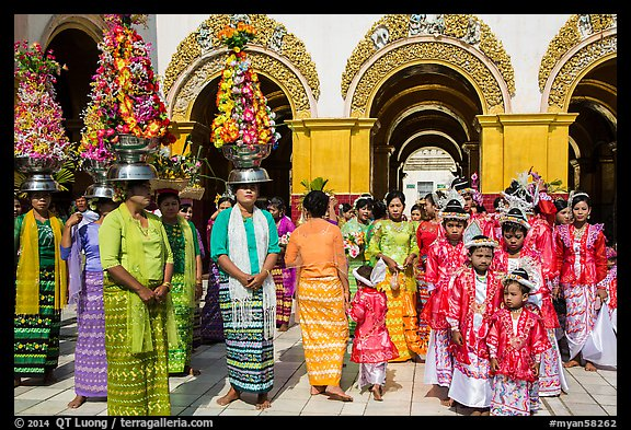 Young children and families gathering for noviciation ceremony, Mahamuni Pagoda. Mandalay, Myanmar (color)