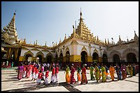 Novices and families walk in procession during Shinbyu ceremony, Mahamuni Pagoda. Mandalay, Myanmar ( color)