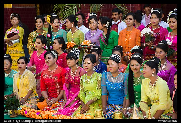 Women pose during novitiation ceremony, Mahamuni Pagoda. Mandalay, Myanmar (color)