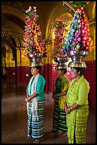 Women carry elaborate flower offerings on their head, Mahamuni Pagoda. Mandalay, Myanmar ( color)