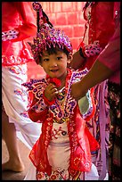 Young girl dressed in glittering attire during novitiation, Mahamuni Pagoda. Mandalay, Myanmar ( color)