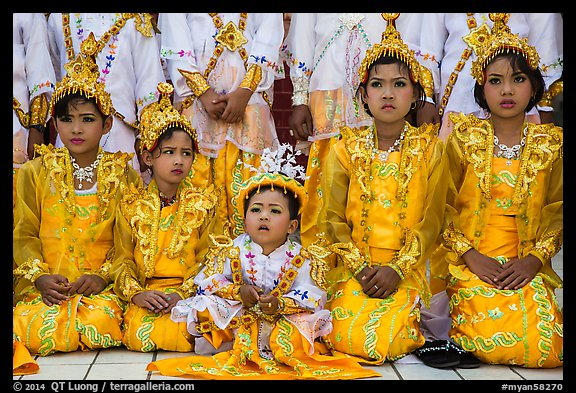 Girls and boy dressed in glittering clothes and make-up to look like princes, Novitiation, Mahamuni Pagoda. Mandalay, Myanmar (color)