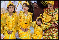 Girls with make-up and princely attire reacting during Noviciation, Mahamuni Pagoda. Mandalay, Myanmar ( color)