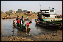 Passengers disembark from boat after short crossing. Mandalay, Myanmar ( color)