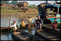 Row boats and huts on shore of Irrawaddy River. Mandalay, Myanmar ( color)