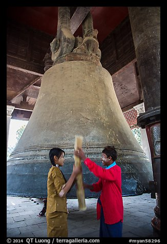 Boy and girl ringing huge bell, Mingun. Myanmar (color)