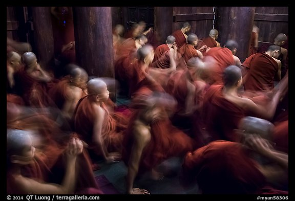 Monks in motion during prayer. Mandalay, Myanmar (color)