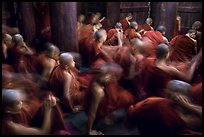 Monks in motion during prayer. Mandalay, Myanmar ( color)
