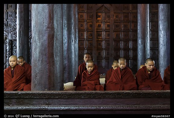Monks during evening prayer. Mandalay, Myanmar (color)