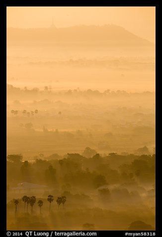 Ridges in mist at sunrise seen from Mandalay Hill. Mandalay, Myanmar (color)