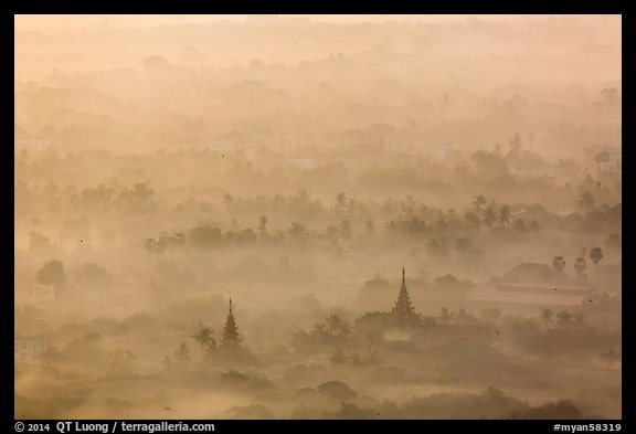Pagodas and tree ridges in mist as seen from Mandalay Hill. Mandalay, Myanmar (color)