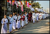Children carry Buddhist flags ahead of alms procession. Mandalay, Myanmar ( color)
