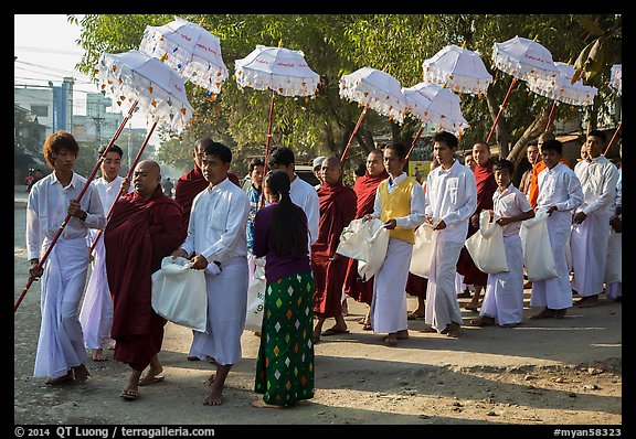 Umbrella bearer, Monks, and donation holders in alms procession. Mandalay, Myanmar (color)