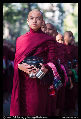 Monks stand in line before lunch, Mahagandayon Monastery. Amarapura, Myanmar (color)