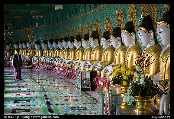 Buddha images in crescent-shaped hall, U Min Thonze pagoda, Sagaing. Myanmar (color)