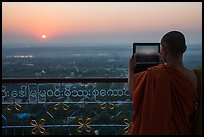 Monk taking picture of sunset from Sagaing Hill. Myanmar ( color)
