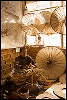 Woman assembling the paper umbrellas carried by the monks. Pindaya, Myanmar ( color)