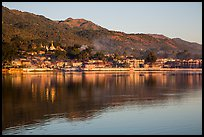 Hill and town reflected in Pone Tanoke Lake at sunrise. Pindaya, Myanmar ( color)
