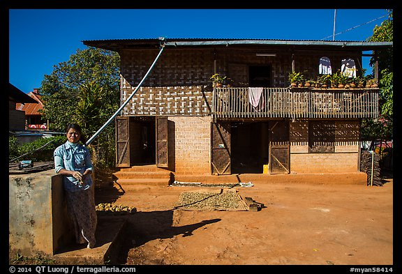 Woman in front of house. Pindaya, Myanmar (color)