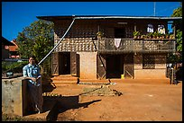 Woman in front of house. Pindaya, Myanmar ( color)