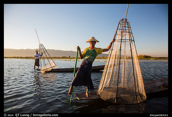Intha fishermen with conical baskets in warm afternoon light. Inle Lake, Myanmar (color)