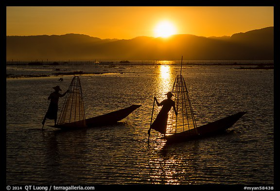 Intha fishermen row with leg with setting sun. Inle Lake, Myanmar (color)