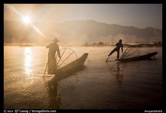 Sun piercing mist behind Intha fishermen. Inle Lake, Myanmar (color)
