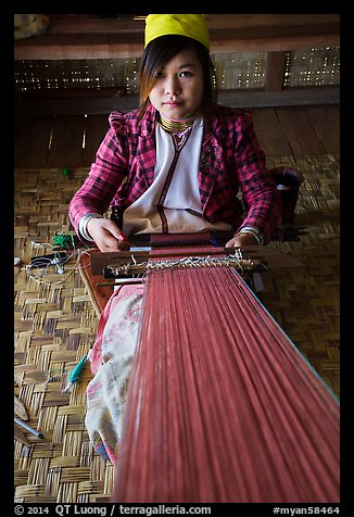Young padaung woman weaving. Inle Lake, Myanmar (color)
