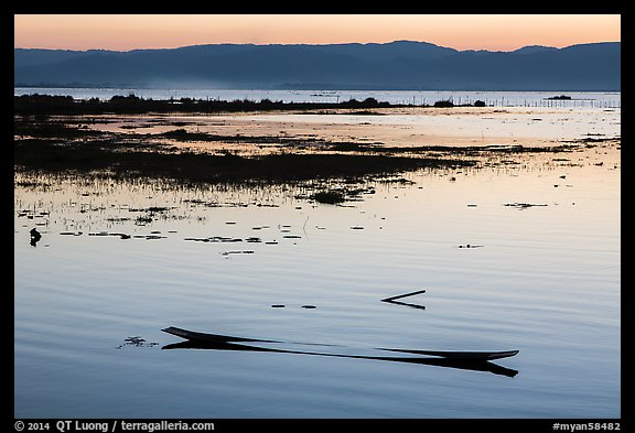 Sunken canoe at sunset. Inle Lake, Myanmar (color)