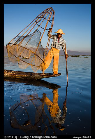 Intha fisherman with freshly caught fish in basket. Inle Lake, Myanmar (color)