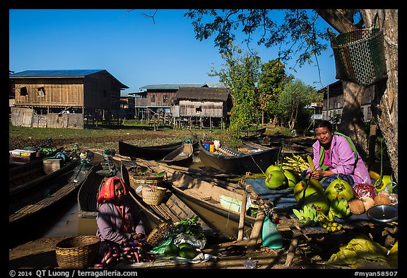 Market, boats, and village houses on stilts. Inle Lake, Myanmar (color)