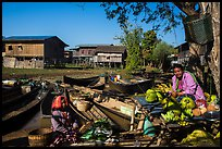 Market, boats, and village houses on stilts. Inle Lake, Myanmar ( color)
