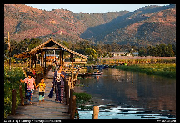 Pier and hills, Maing Thauk Village. Inle Lake, Myanmar (color)